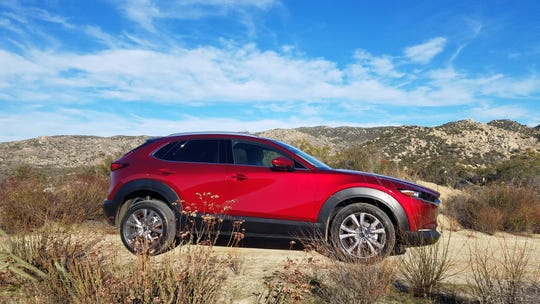 The 2020 Mazda CX-30 is based on the same platform as the Mazda 3 hatchback — and shares the compact car's excellent handling as a result.