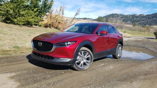 The 2020 Mazda CX-30 sports heavy black cladding in a nod to adventurous, off-road SUV ambitions. The athletic CX-30's real talents, however, are on asphalt.