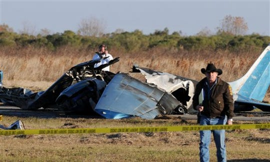 Acadia Parish Sheriff's Department and other law enforcement make a preliminary investigation of a fatal plane crash, Saturday, Dec. 18, 2010, at Le Gros Memorial Airport in Esterwood, La.