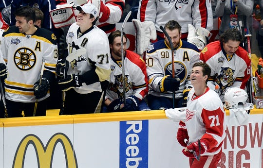 Red Wings forward Dylan Larkin, right, looks up at scoreboard after competing in the fastest skater event at the 2016 NHL All-Star skills competition in Nashville.