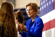 Democratic presidential candidate Sen. Elizabeth Warren, D-Mass., greets a student after speaking at an assembly at Roosevelt High School in this Oct. 21, 2019, file photo in Des Moines, Iowa.