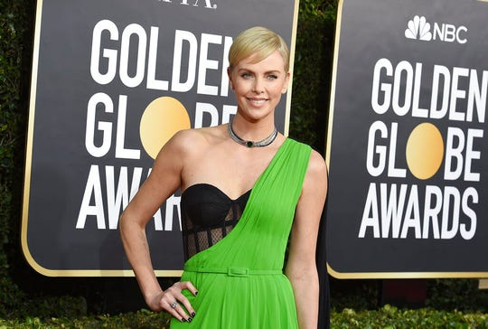 Charlize Theron arrives at the 77th annual Golden Globe Awards on Sunday, Jan. 5, 2020, in Beverly Hills. Theron has said Weinstein falsely claimed the two had been sexually intimate as a way of manipulating her.