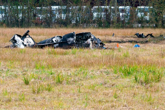 A view of the burnt wreckage of a small plane that crashed into the parking lot of a post office is shown in Lafayette, La., Saturday, Dec. 28, 2019. Several people died in the crash.