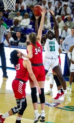FGCU's Nasrin Ulel looks to score on Liberty's Bridgette Rettstatt. FGCU women's basketball faced Liberty in their ASUN game at Alico Arena. The Eagles are ranked 25th in the USA Today Coaches Poll. FGCU won 64-57.
