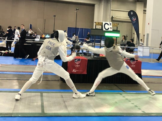 Barron Collier senior David Tierney, left, recently committed to Duke where he will compete on the Division I fencing squad.