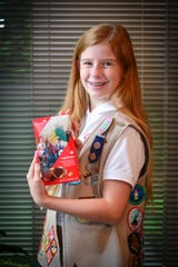 Olivia Trader of Cape Coral is one of six Girl Scouts in the nation to be picked to grace the box of the group's famous cookies. She competed for the honor by taking part in Girl Scouts of the USA's 2018 Girl Scout Cookie Pro™ Contest and can be seen on the newly redesigned Tagalongs cookie box for the 2020 sales.