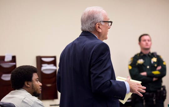 Jeovanni Hechovarria, left, appears in court with his attorney Allen Kaufman, center, before jury selection in his trial on Jan. 7, 2020.
