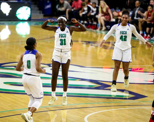 FGCU's Nasrin Ulel, and Tytionia Adderly celebrate Davion Wingate's basket to keep their lead. FGCU women's basketball faced Liberty in their ASUN game at Alico Arena. The Eagles are ranked 25th in the USA Today Coaches Poll. FGCU won 64-57.