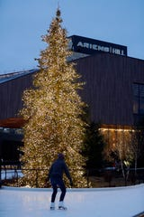 A balsam fir dripping in lights has become a popular spot for engagement in the Titletown District.