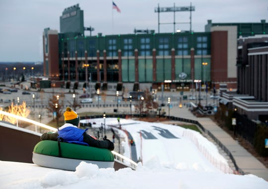 A snow tuber gets a view of Lambeau Field as he begins the ride down Ariens Hill on Jan. 3 in the Titletown District. This year's tube ride is 150 feet longer.