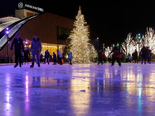 Ice skaters circle the rink at the Green Bay Packers' Titletown District on Jan. 2. The park's many trees stay lit all winter.