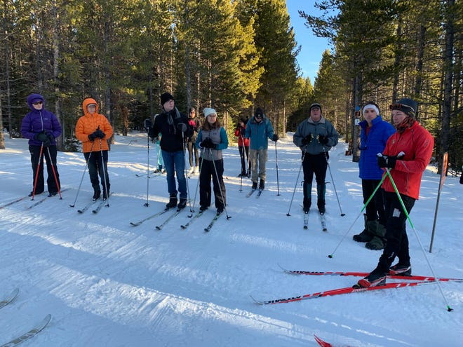 Ski instructor Kyle Marvinney (far right) leads a cross-country ski clinic at Silver Crest Trails in the Little Belt Mountains.