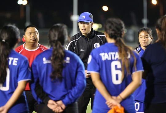 Coach Sang Hoon Kim, wearing hat, speaks with members of the Guam women's national team training squad during a training session at the Guam Football Association National Training Center in this file photo. Kim returns to Guam to assume the role of GFA Technical Director and Head Coach of the Masakåda, Guam Women's National Team.