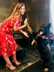 """Jamie Little greets Mattis, a Georgia-based police K-9, at a promotional event for """"America's Top Dog."""""""