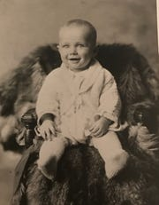 Keith Dougherty shown as a baby before his family lost their home and farm during the Great Depression.