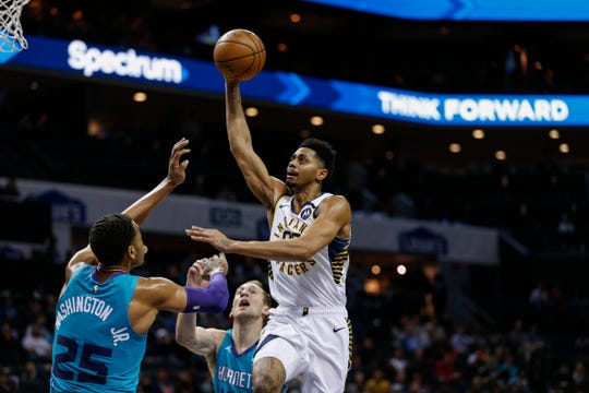 Indiana Pacers guard Jeremy Lamb, right, shoots over Charlotte Hornets forward P.J. Washington in the second half of an NBA basketball game in Charlotte, N.C., Monday, Jan. 6, 2020.