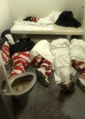 Multiple inmates sleep inside a cell in this photo allegedly taken inside Parchman's Unit 32. Prisoner rights attorney Ron Welch said he has a source inside the prison that confirmed the photo is from Unit 32. The Clarion Ledger cannot independently verify when and where the photo was taken.