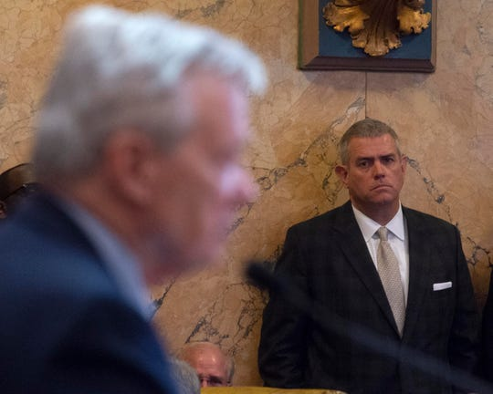 Miss. state representative Mac Huddleston ,left, speaks in favor of representative Philip Gunn, right, as house speaker as Gunn watches from the floor of the house during the opening day of the 2020 Miss. legislature. Tuesday, Jan. 7, 2020.