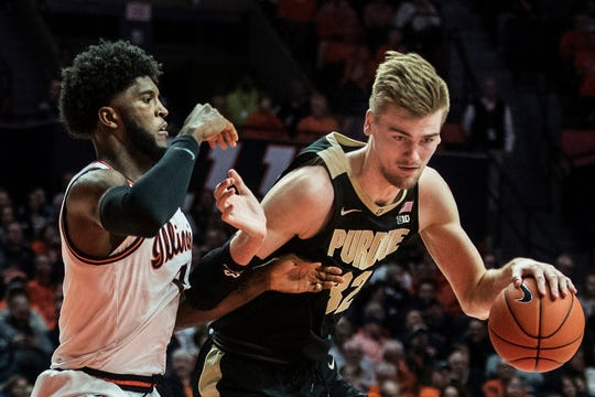Purdue's Matt Haarms (32) is pressured by Illinois' Kipper Nichols (2) in the second half of an NCAA college basketball game, Sunday, Jan. 5, 2020, in Champaign, Ill. (AP Photo/Holly Hart)