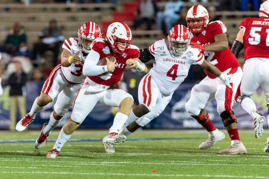 UL's Joe Dillon (3, left) and Zi'Yon Hill (4), shown here chasing down Miami (Ohio) quarterback Brett Gabbaert in the LendingTree Bowl, both are slated to return in 2020.
