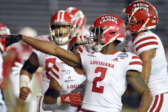 Jan 6, 2020; Mobile, Alabama, USA; Louisiana-Lafayette Ragin Cajuns wide receiver Ja'Marcus Bradley (2) celebrates his touchdown against the Miami (Oh) Redhawks during the third quarter at Ladd-Peebles Stadium. Mandatory Credit: John David Mercer-USA TODAY Sports