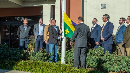 Mayor-President Josh Guillory raises the Mardi Gras flag at the Lafayette Consolidated Goverment building, marking the start of carnival season. Tuesday, Jan. 7, 2020.