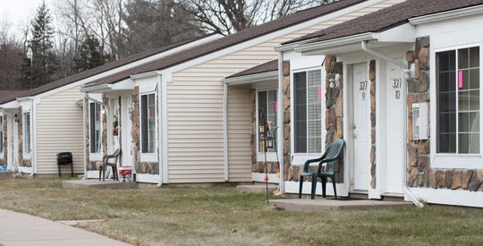 Freshly-placed pink tags placed by workers from the City of Lansing Office of Code Compliance were placed on housing units at Capitol Village Apartments in the 300 block of E. Edgewood Boulevard in  Lansing, Tuesday morning, Jan. 7, 2020. Residents say the tags were removed by management after the city initially posted them Monday.