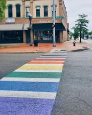 The City of Lansing painted the crosswalk rainbow outside Strange Matter Coffee in June 2019.
