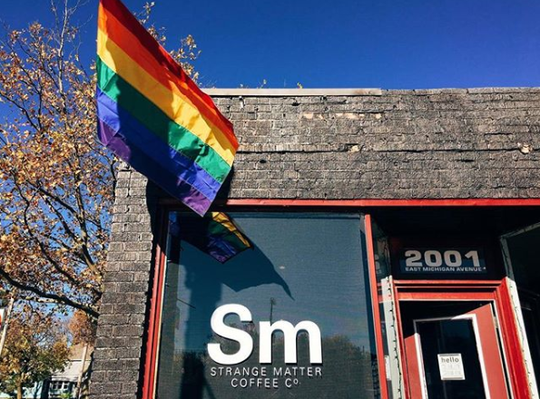 Cara Nader, owner of Strange Matter Coffee, hung a rainbow flag outside her original Michigan Avenue location in November 2016.