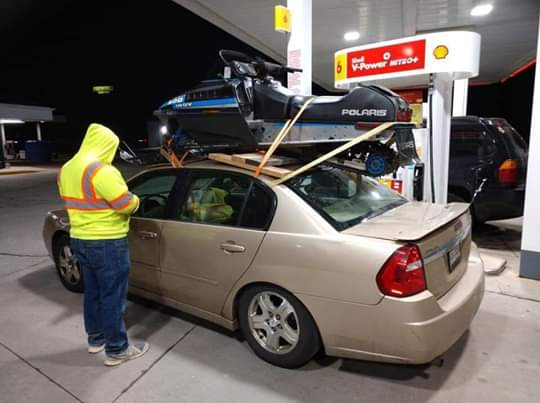 Tommy Mecher stops to gas up in Wisconsin while traveling from Chicago to Bessemer, Michigan, last weekend. Mecher didn't have a snowmobile trailer and didn't want to pay for the extra gas to tow a trailer on the trip.