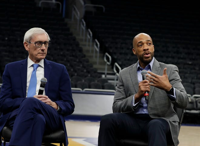 Lt. Gov. Mandela Barnes addresses the media as Gov. Tony Evers watches during media day Tuesday at the Fiserv Forum in advance of the Democratic National Convention set for July 13-16 in Milwaukee.