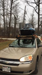 Tommy Mecher didn't have a snowmobile trailer to take his 1990 Polaris Indy 500 snowmobile from Chicago to Bessemer, Michigan, last weekend so he loaded it on top of his 2005 Chevy Malibu. It took him about an hour with a tractor to put the snowmobile on top of his car and about 10 minutes to get it off with the help of a front end loader.