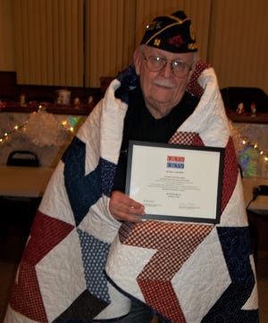 """U.S. Army veteran Michael Nighbert was recently awarded a Quilt of Valor by the Mountain Home Quilts of Valor Group during a ceremony at the Alley-White American Legion Post #52 in Mountain Home. Nighbert served in the 1st Aviation Brigade, 13th Aviation Battalion in Can Tho province from 1966-1968.  The Brigade was also known as the """"Guardian of the Delta"""", referring to the Mekong Delta of Vietnam. For more information about the Quilts of Valor program, please visit http://www.QOVF.org."""