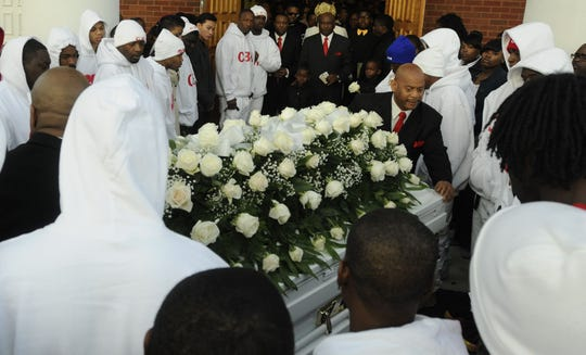 Pallbearers carry the casket holding the body of Glenn Lamar Thomas, also knownon Jan. 3, 2013