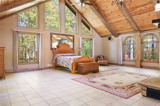A log home sits on 30 acres of farm land at 2400 W. County Road 500 S. Listed at $640,000, the home has 11 rooms that bring rustic and modern together.