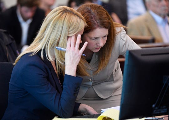 Deputy District Attorney Amy Hunter, right,  confers with Assistant District Attorney Jan Norman during a hearing for Michael Mosley before Judge Melissa Blackburn in court at the Justice A.A. Birch Building in Nashville, Tenn,. Tuesday, Jan. 7, 2020. Mosley is accused in the fatal stabbing of two Williamson County college students, Clayton Beathard and Paul Trapeni III, and injurying of a third student outside a Nashville bar last month.
