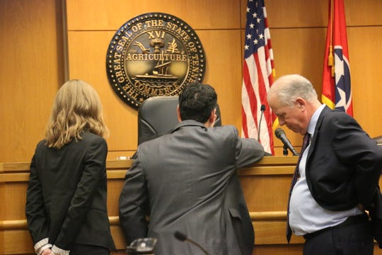 Attorneys Shyanne Riddle, Carlin Hess and Rob McKinney approach the bench of Judge Michael Binkley on Jan. 7, 2020.