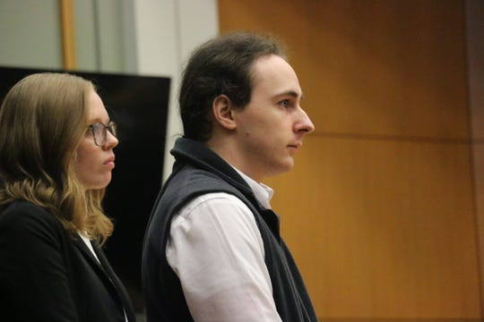 Defendant Jonathon Kyle Elliott and his attorney Shyanee Riddle stand together in a Williamson County courtroom on Jan. 7, 2020.