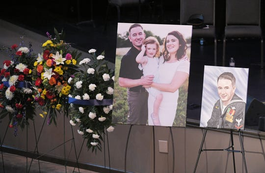 Family photos and a painting are on display near the casket of Hendersonville Master Patrol Officer Spencer Bristol at First Baptist Church Hendersonville on Tuesday, Jan. 7, 2020.
