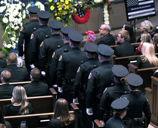 Hendersonville police officers line up to salute Master Patrol Officer Spencer Bristol's casket during his funeral at First Baptist Church Hendersonville on Tuesday, Jan. 7, 2020.