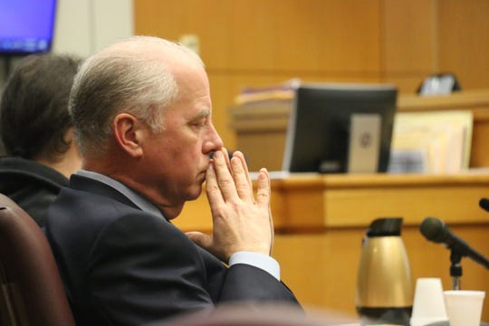 Defense attorney Rob McKinney sits in the courtroom during the trial of his client Jonathon Kyle Elliott on Jan. 7, 2020.