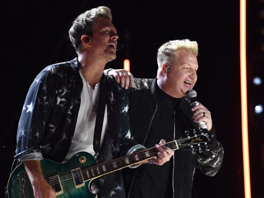 Joe Don Rooney and Gary LeVox of Rascal Flatts perform during the 2019 CMA Fest Thursday, June 6, 2019, at Nissan Stadium in Nashville, Tennessee.