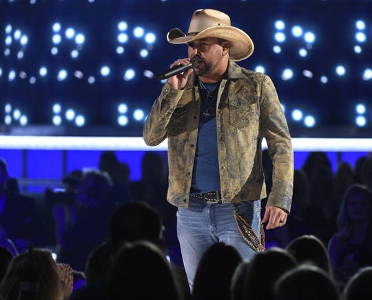 "This April 7, 2019 file photo shows Jason Aldean performing ""Can't Hide Red"" at the 54th annual Academy of Country Music Awards in Las Vegas."