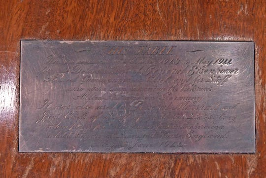 This plaque could add thousands of dollars in value because it states that Eisenhower and other WWII leaders planned the Normandy Invasion on this table.