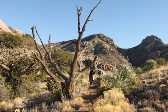 Hikers proceed along the Achenbach Canyon trail in the Organ Mountains-Desert Peaks national monument on Sunday, Jan. 5, 2020.