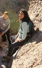 U.S. Rep. Xochitl Torres Small, D-NM, rests during a group hike on the Achenbach Canyon trail in the Organ Mountains-Desert Peaks national monument on Sunday, Jan. 5, 2020.