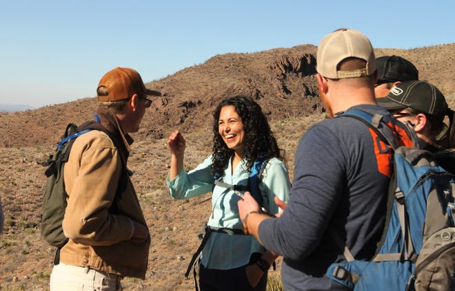U.S. Rep. Xochitl Torres Small, D-NM, at center, participated in a group hike on the Achenbach Canyon trail in the Organ Mountains-Desert Peaks national monument on Sunday, Jan. 5, 2020.