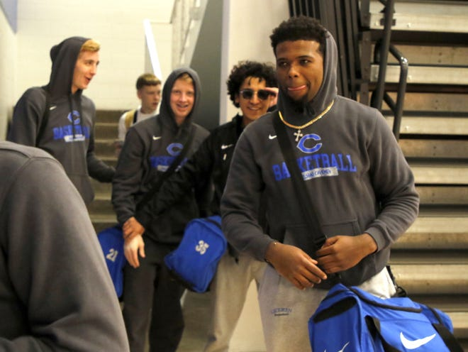 Members of the Carlsbad Cavemen basketball team leaves the Carlsbad gymnasium in the afternoon before heading to Artesia for a 7 p.m. game.