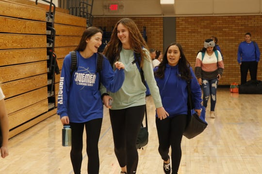 Members of the Carlsbad Cavegirls basketball team leaves the Carlsbad gymnasium in the afternoon before heading to Artesia for a 5:30 p.m. game.