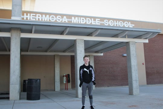 Sixth grade student Kender Dibble stands outside of Hermosa Middle School, Tuesday, Jan. 7, 2020, in Farmington after returning from winter break.